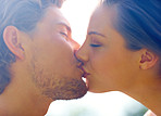 Portrait of a romantic young couple kissing with eyes closed