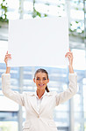 Portrait of a young business woman holding a blank sheet