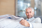 An aged business man reading newspaper