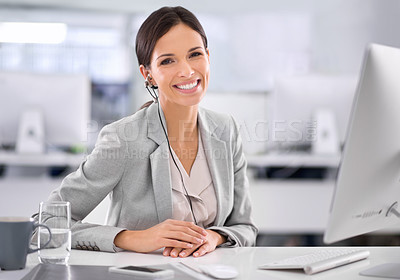 Buy stock photo Shot of an attractive businesswoman sitting at her desk in an office