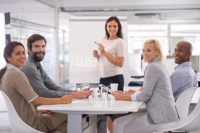 Buy stock photo Shot of a businesswoman giving a presentation to her colleagues
