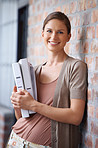happy woman in gray blouse with documents