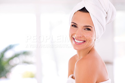 Buy stock photo A beautiful woman with pure, perfect skin looking over her shoulder