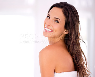 Buy stock photo A beautiful woman wrapped in her towel looking over her shoulder