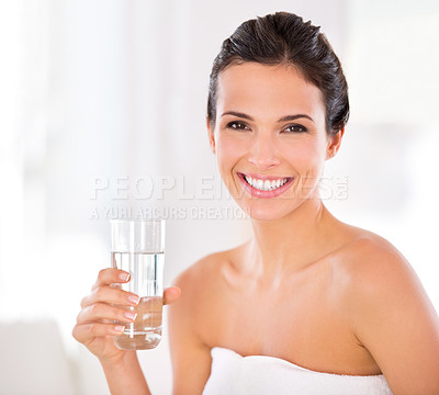 Buy stock photo Portrait of a beautiful woman holding a glass of water