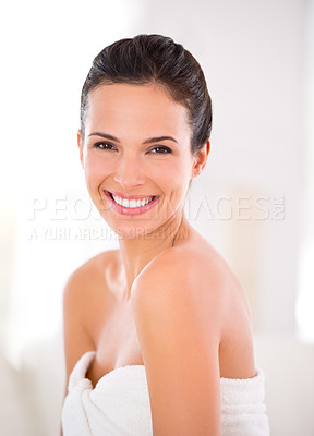 Buy stock photo A woman with flawless skin smiling while looking over her shoulder