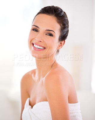 Buy stock photo Portrait of a beautiful woman with a towel wrapped around her body