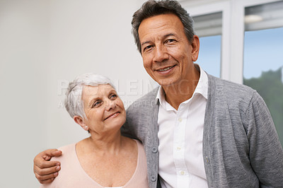 Buy stock photo Shot of an affectionate elderly couple at home
