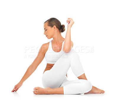 Buy stock photo A sporty young woman stretching against a white background