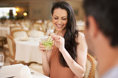 Buy stock photo Shot of a beautiful young woman on a date with her husband
