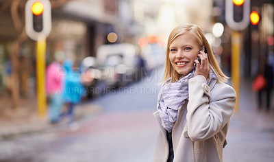 Buy stock photo Cropped shot of a young woman talking on her cellphone