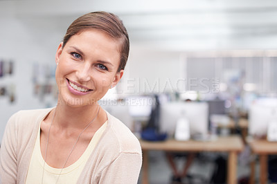 Buy stock photo Portrait of an attractive young businesswoman in an office