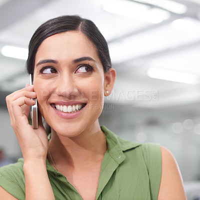 Buy stock photo Shot of a young businesswoman talking on a cellphone