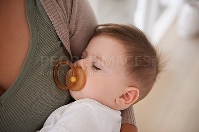 Buy stock photo Cropped shot of a mother holding her sleeping baby boy