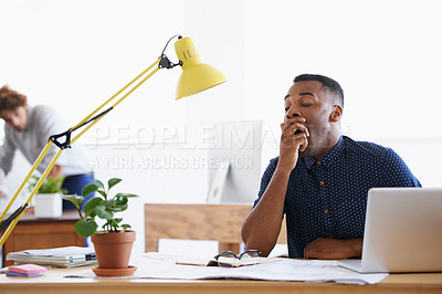 Buy stock photo A young man in his office