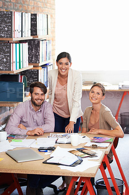 Buy stock photo Shot of a young creative professionals working in an office