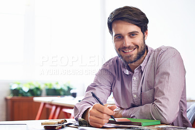 Buy stock photo A young designer smiling in his office