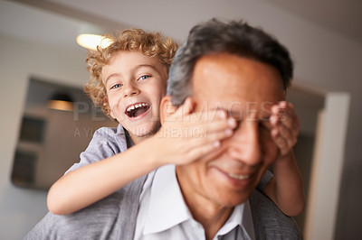Buy stock photo Shot of a playful little boy and his grandfather