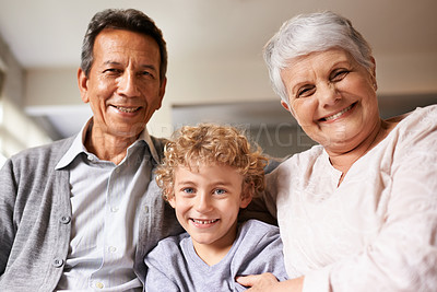 Buy stock photo Portrait of a little boy sitting between his grandparents