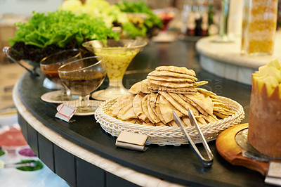 Buy stock photo A selection of sides and dishes on a rotating buffet table
