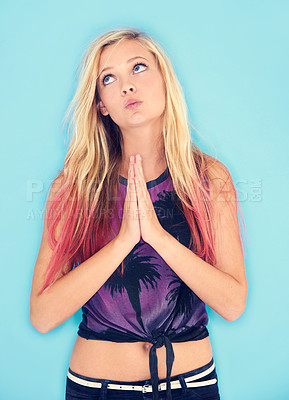 Buy stock photo An attractive and trendy young woman posing against a blue background