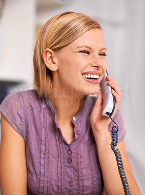 Buy stock photo Shot of a beautiful young woman using a phone at her desk