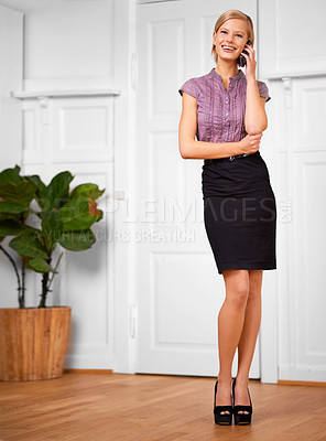 Buy stock photo Portrait of a beautiful young office worker talking on her phone