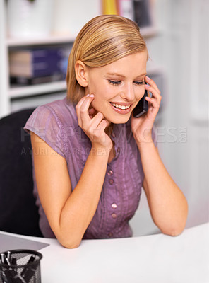 Buy stock photo Shot of a beautiful young woman on the phone at work