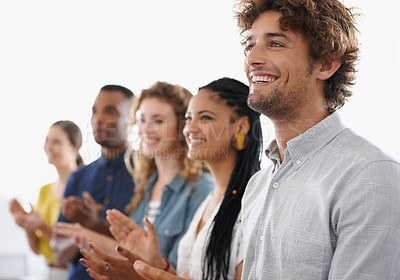Buy stock photo Shot of a group of smiling office workers clapping