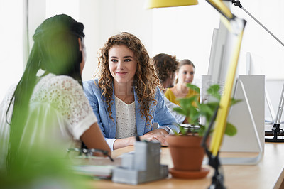 Buy stock photo Shot of young designers talking while working in the office