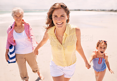 Buy stock photo Portrait of a woman with her daughter and mother at the beach