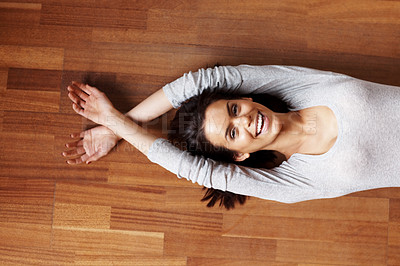 Buy stock photo Pretty young woman relaxing on the floor