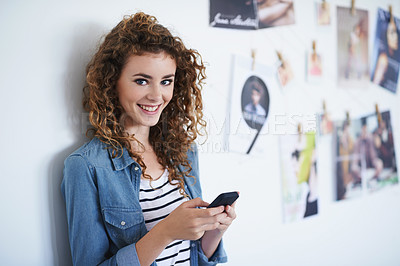 Buy stock photo Portrait of a young woman texting in her office