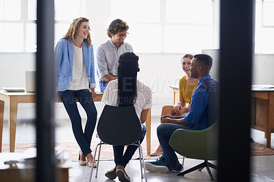 Buy stock photo Shot of or a group of young business people having a brainstorming session