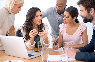 Buy stock photo Shot of a group of business people in the middle of a discussion