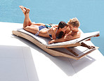 Romantic couple relaxing on a deck chair