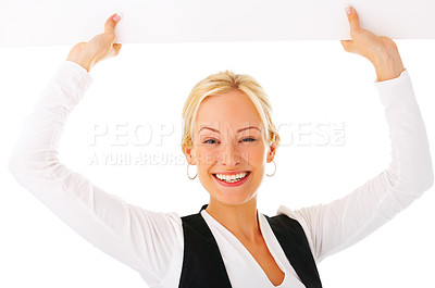 Buy stock photo Studio shot of a young woman holding up a blank sign isolated on white