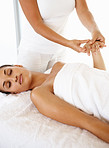 Pampered woman treating herself with a massage by a professional masseuse