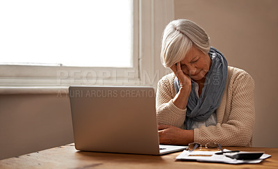 Buy stock photo An elederly woman sitting in front of her laptop looking stressed and worried