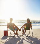 Sunset: Young couple enjoying their summer vacation