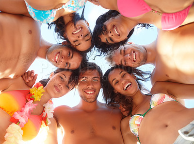 Buy stock photo Upwards view of friends in a huddle