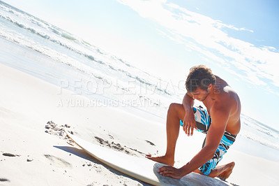 Buy stock photo Tired young man with a surf board at the beach