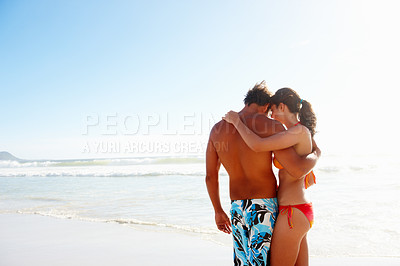 Buy stock photo Portrait of romantic couple embracing eachother at the beach