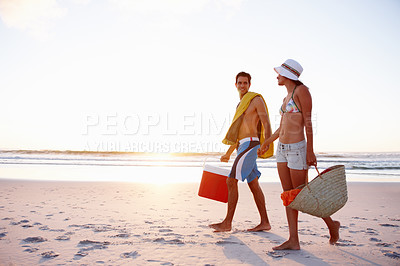 Buy stock photo Happy young couple strolling together on the beach