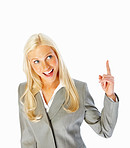Cheerful young business woman pointing upwards on white background