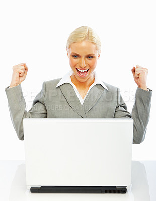 Buy stock photo A pretty successful business woman with her hands raised while working on laptop