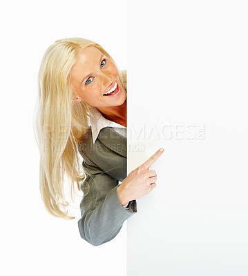 Buy stock photo Portrait of a happy young business woman pointing at copyspace