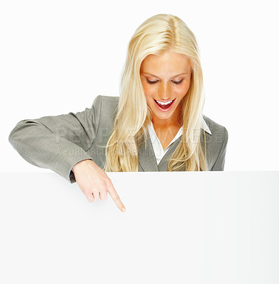 Buy stock photo Cute business woman pointing towards a blank board
