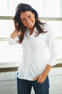 Buy stock photo Portrait of a confident young woman posing