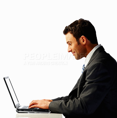 Buy stock photo Profile view of a business man working on a laptop over white